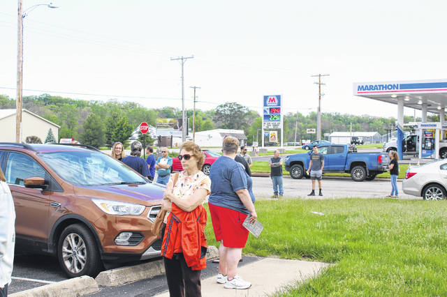 Elaine Fitchpatrick, of Port Jefferson, waits in line at the Sidney BMV on Tuesday, May 26, 2020, the first day it has been opened since March. Fitchpatrick has been waiting to get the tags on her vehicle switched since Gov. Mike DeWine ordered the closure of BMVs across Ohio in March. Fitchpatrick had arrived at the BMV just before it opened at 8 a.m. Tuesday, and had been waiting in line for half an hour at the time the photo was taken.