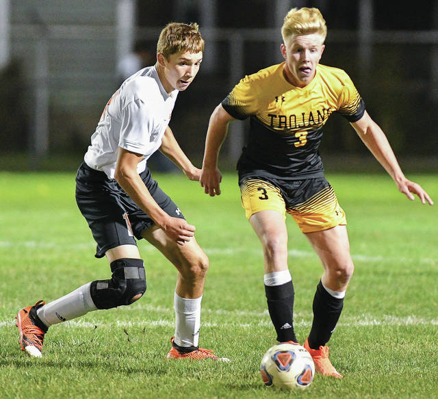 Botkins' Zane Paul, right, dribbles with pressure from Jackson Center's Camdyn Reese in the first half of a Division III district semifinal on Oct. 22, 2019 at Wertz Stadium in Piqua. The National Federation of State High School Associations released recommendations for the resumption of prep athletics late last week.