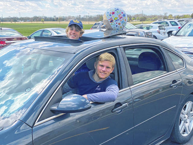 Michael and Zachary Bell, left to right, of Russia, sons of Beth Bell, Versailles Rehab senior director of business development, participate in the car parade on Sunday at Versailles Rehabilitation and Healthcare Center.