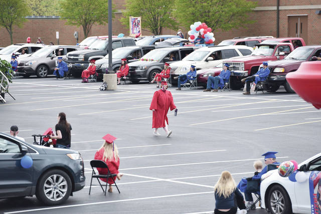 Marissa Ann-Gayle Shoe walks back to her chair after receiving her diploma during the 2020 Riverside High School graduation held in the Riverside High School parking lot to prevent the spread of COVID-19. The graduation was held on Saturday, May 16.