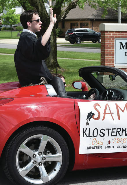 Minster High School senior Sam Klosterman takes part in the Minster High School graduation parade on Sunday, May 24. The parade started at the Minster High School and wound through town as relatives and well wishers waved.