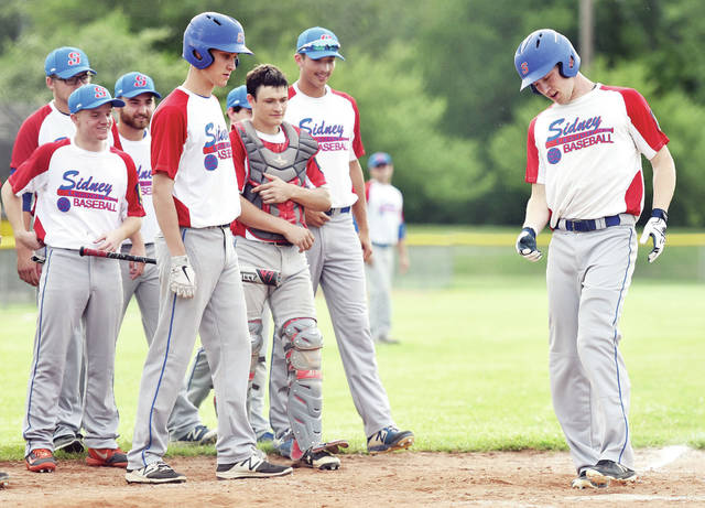 Sidney Post 217's Kurtis Rutschilling puts his foot down after hitting a home run against Greenville Post 140 during an American Legion baseball game on June 5, 2019 in Sidney. The Ohio American Legion canceled the organization's 2020 season on Monday due to the state's extension of group size restrictions.