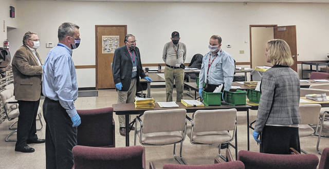 Practicing social distancing while discussing the ballots received for the March 17 Primary Election are, left to right, Jim Kerg, Jim Thompson, Doug Pence, Merrill Asher, Deputy Director Donnie Chupp and Director Pam Kerrigan.
