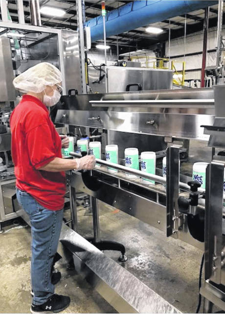 Mary Jo Bowman, of Anna, is monitoring the production flow of the Wet Ones canisters as they come down the production line on Tuesday, May 12, made at Edgewell Personal Care on Progress way.