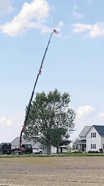 Ian Luthman, a U.S. Army veteran, raised his American flag high into the sky thanks to his tree service equipment. Luthman raised the flag at his residence on Wenger Road, Botkins, in honor of Memorial Day.
