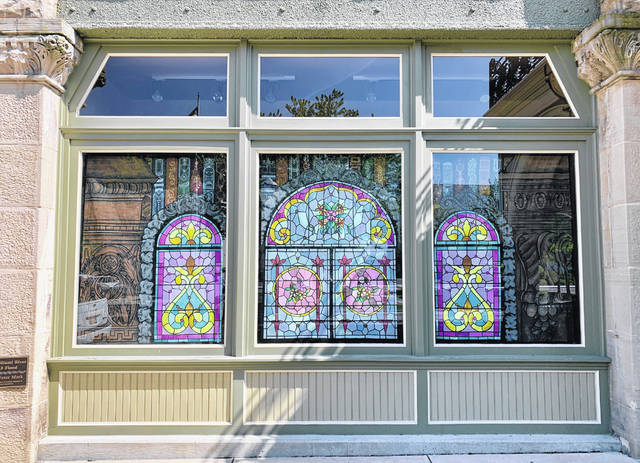 Gabbie Braun's window art is on display at the {iqua Public Library.