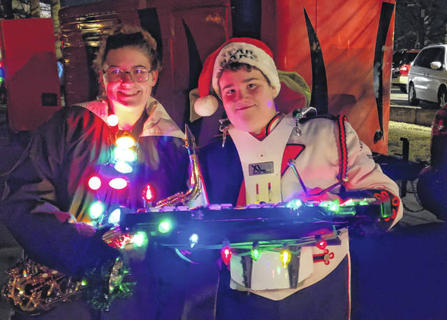 Haley Hatfield's favorite memory is marching in the Christmas parade. She is pictured her with her cousin, Jaiden Hatfield, who is a member of the Jackson Center High School band.
