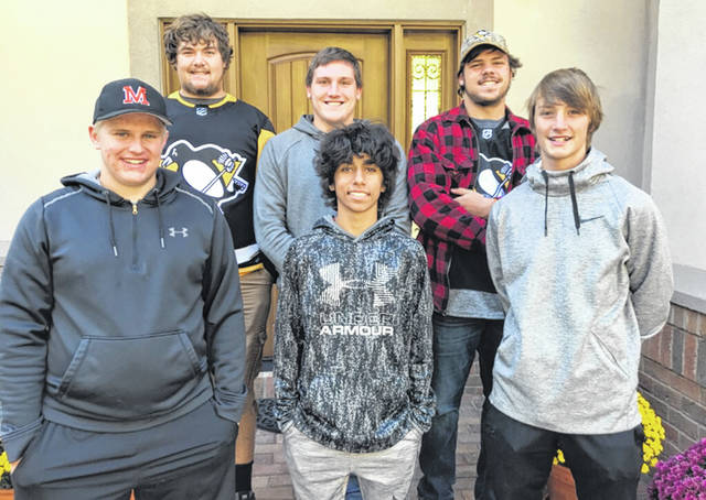 Minster High School students Alex Frimmel, Chase Couse, Devin Wuebker, Dylan Sharp, Kyle Riethman and Dustin Frericks decided to attend a Cyclone hockey game instead of going to the homecoming dance.