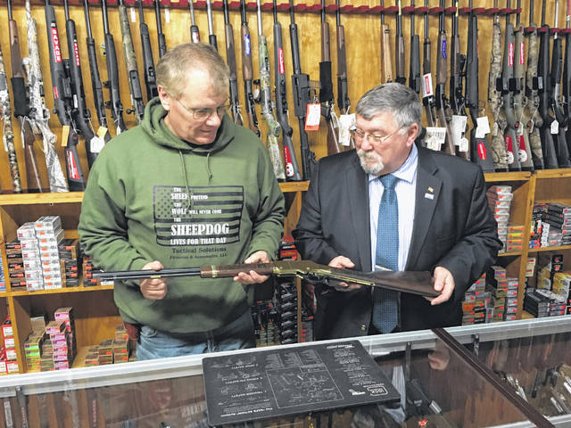 Mark Henman, of Tactical Solutions, left, examines the Serial No. 1 Henry Standard Sidney Bicentennial Commemorative Rifle along with Shelby County Commissioner/Sidney Bicentennial Committee Co-Chair Bob Guillozet in preparation for the sale of raffle tickets. The proceeds of the sale of the raffle tickets will be used to help support the expenses of Sidney's Bicentennial celebration.