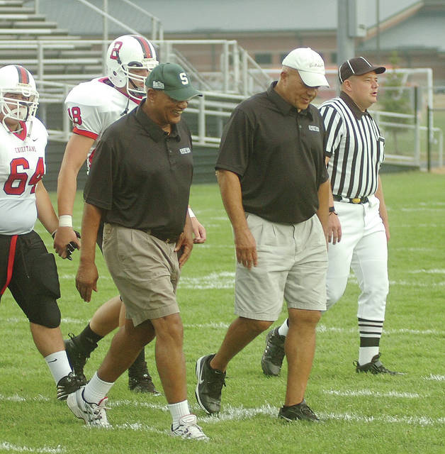 Jesse Williams, left, and Gail Clark head to the pregame coin toss at Sidney Memorial Stadium on Sept. 29, 2008, marking 40 years since the classic Bellefontaine vs. Sidney football game of 1968.