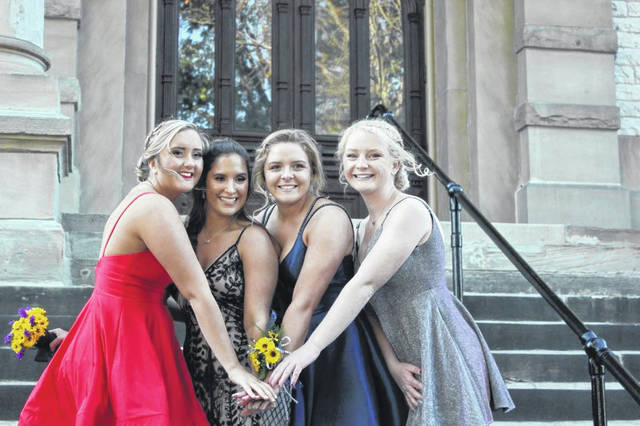 Sidney High School friends Kaitlyn VanZant, Lydia Brewer, Faith Bockrath and Carly Dean pose for a photo before the 2019 homecoming dance.