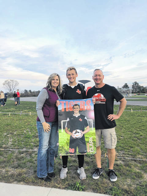 This photo means a lot to me because I accomplished four years of Varsity Soccer, and having my two biggest supporters alongside me (mom and dad)