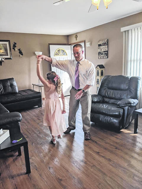Father and daughter, Mike and Emma Koenig, talk a spin around the dance floor.