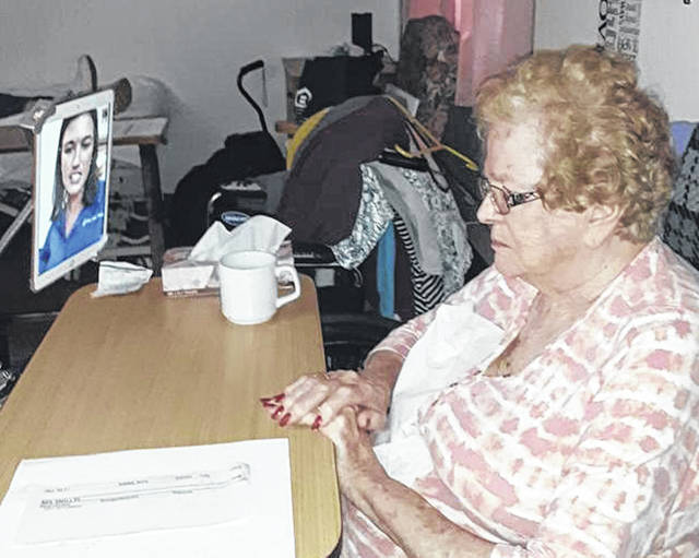 Versailles Rehabilitation and Healthcare Center long-term care resident Ruth Wirrig talks with her granddaughter, Marissa Wirrig, as part of the center's iPad video call program.