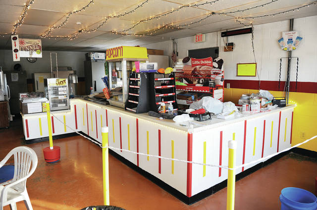 The Sidney Auto-Vue Drive-In has been busy. The concession stand has gotten a new look with red and yellow stripes on a white background. A row of lights has also been added just under the countertop. Some of the fences and posts outside have also gotten new paint. The bathrooms were also repainted with a new look. The Sidney Auto-Vue Drive-In operators are tentatively planning on opening this summer.