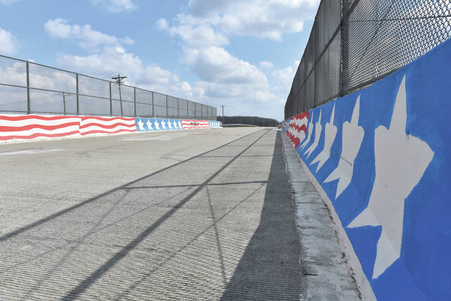 The Patterson-Halpin Road railroad bridge has gotten a patriotic paint job recently from an unknown artist. The bridge is located on Patterson-Halpin Road just north of its intersection with Smalley Road.