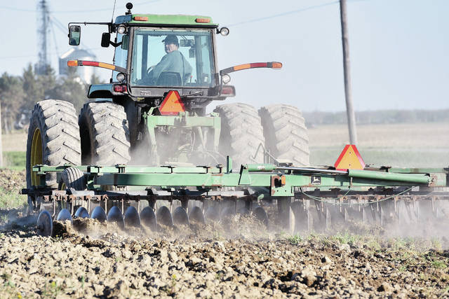 Roger Lentz, of Anna, tills the soil on his farm located at the intersection of state Route 29 and Fort Laramie Swanders Road on Wednesday, May 6. Lentz plans on planting soybeans if the weather continues to cooperate. Lentz said last year's planting was significantly delayed due to bad weather.