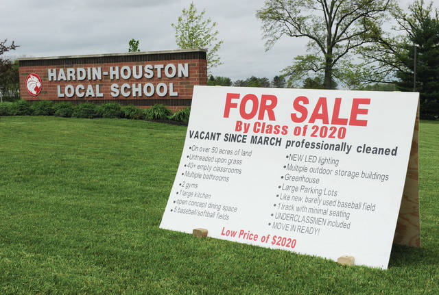 Harding-Houston Local School seniors put up a humorous for sale sign in front of their school on Thursday, May 21.
