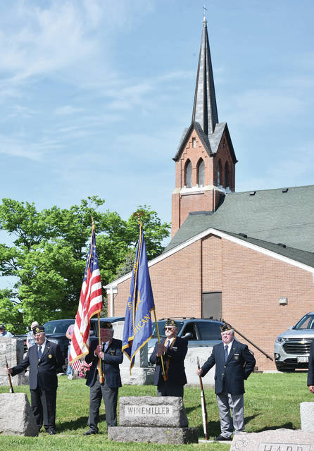 The Fort Loramie American Legion Post 355 takes part in a Memorial Day ceremony at Houston Cemetery on Sunday, May 24. The Fort Loramie American Legion Post 355 performed a rifle salute and Taps were played. Houston Congregational Christian Church Pastor Kris Geise spoke during the ceremony.