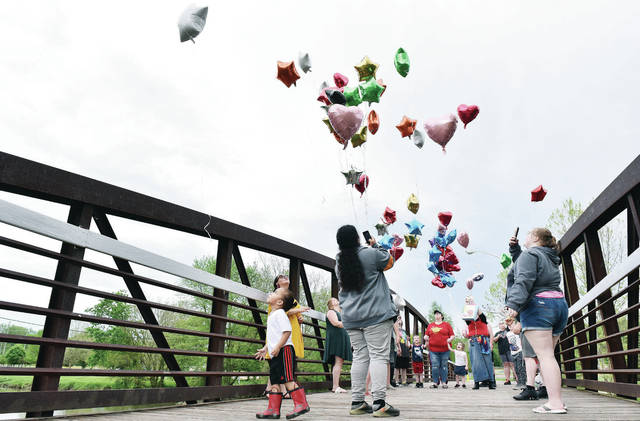Balloons are released by friends and family on Stolle Bridge in memory of Kristeenu Clack on Monday, May 25. Clack passed away after an accident on the great Miami River near Stolle Bridge on Monday, April 27.