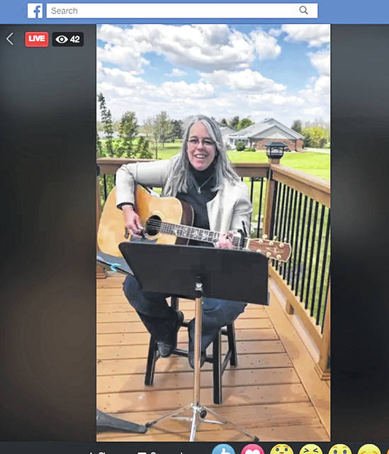 Susan Kramer plays guitar Thursday afternoon during Shelby County's celebration of the 2020 National Day of Prayer. Shelby County's celebration was broadcast on Facebook Live.