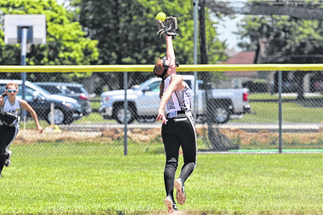 Russia's Saige Hoying makes an over the shoulder catch in the teams win over Lancaster. The Cannons, a 14U softball program, are hosting their own softball tournaments while others across the region are getting canceled.