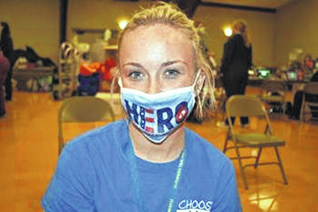 """Fort Loramie donor Shelby Bohman wears her CBC """"Hero"""" face mask at St. Michael's June 16 blood drive."""