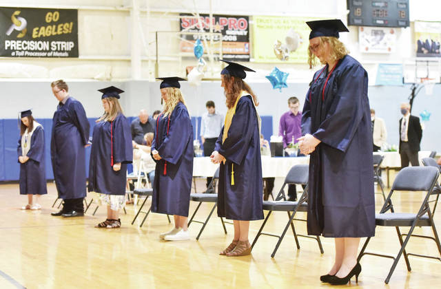 Christian Academy Schools class of 2020 pray during their commencement program on Friday, June 12.