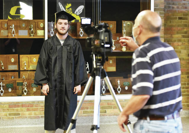 Riley Barnes, left, 18, of Sidney, son of Jamie and Daniel Barnes, prepares to say his name as he is videotaped by Sidney High School Principal Denny Morrison at Sidney High School.