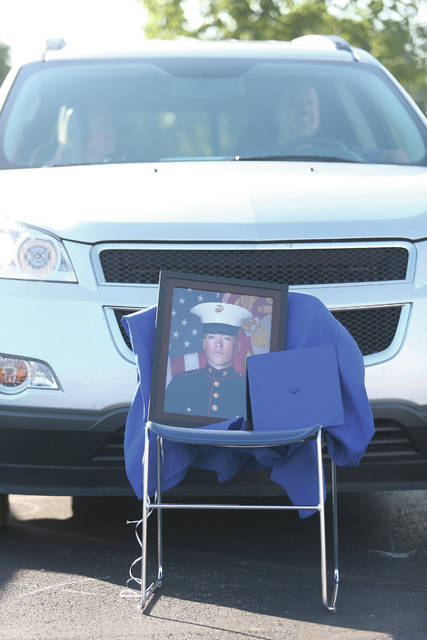 Garrett Kramer has his spot reserved for graduation with his Marine photo at the 2020 Fairlawn High School graduation ceremony on Friday, June 19.