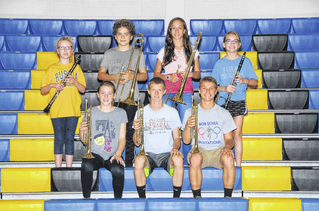 displaying Russia High School's seven new instruments are , back row, left to right, Kassie Harvey, Cyril Cordonnier, Grace Holscher and Madison Schulte; and front row, Lilly McClenen, Levi Delaet, and Jacob Goubeaux.