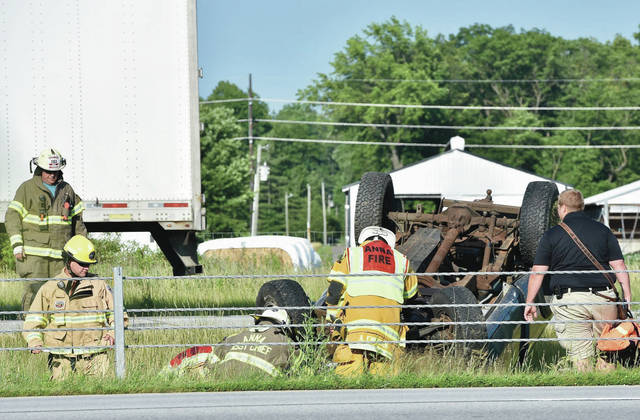 Anna firefighters respond to a one-vehicle rollover accident in the median of Interstate 75 at the 101 mile marker north of Anna on Wednesday, June 24. The Ohio State Highway Patrol also responded.