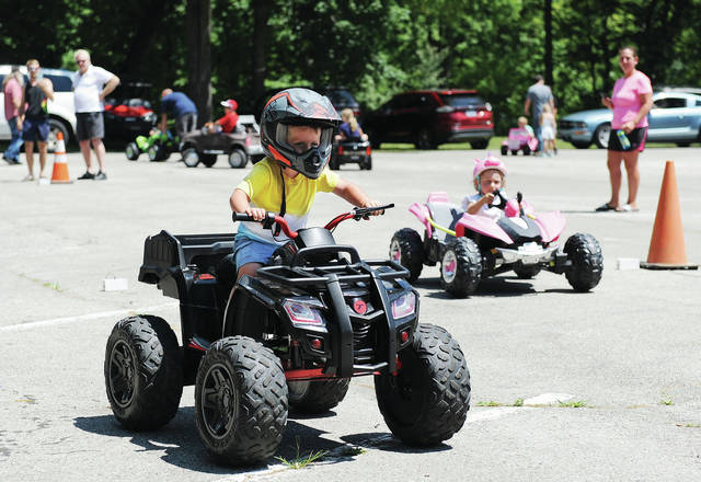 Easton Shrewsbury, left, 2, son of Cory Shrewsbury and Cassie Kinell, pulls ahead of Josephine Szostek, 4, both of Sidney, daughter of Henry Szostek, during a kiddie drag race at the Cruise-In held by the Shelby County Historical Society in Tawawa Park on Saturday, July 18.