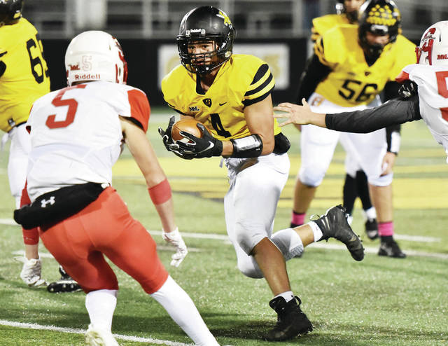 Sidney's E.J. Davis runs the ball against Stebbins on Oct. 25, 2019, at Sidney Memorial Stadium. Interim Ohio High School Athletic Association Executive Director Bob Goldring said the OHSAA will stick to its previously scheduled date of Aug. 1 for the beginning of practice for fall sports.
