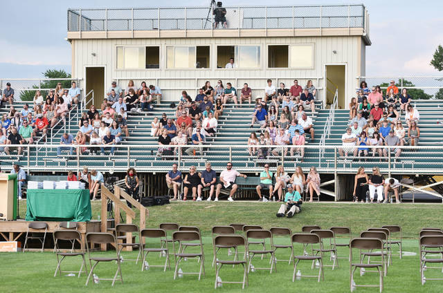Friends and family wait for the Anna High School commencement ceremony to begin on Thursday, July 2.