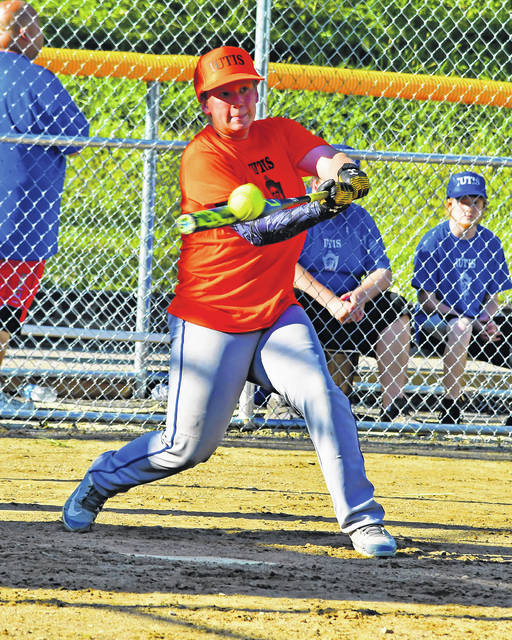 Anthony Earick, son of Sandy Earick, makes contact with a pitch during opening night of Sidney IUTIS Club softball on Monday.