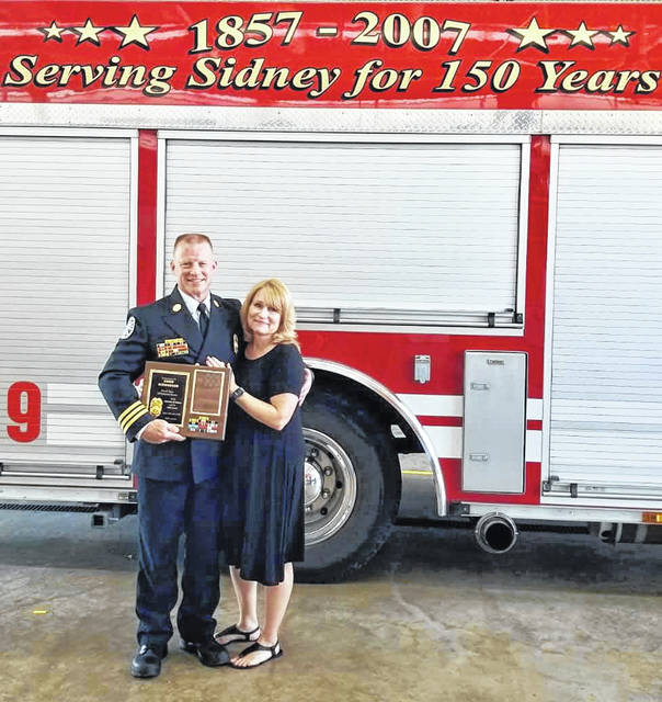 Retired Sidney Fire Assistant Chief Chris Niswonger, and wife Laura, at his retirement ceremony at Fire Station 1 on July 3. Niswonger retired from Sidney Fire & Emergency Services after over 27 years of service.
