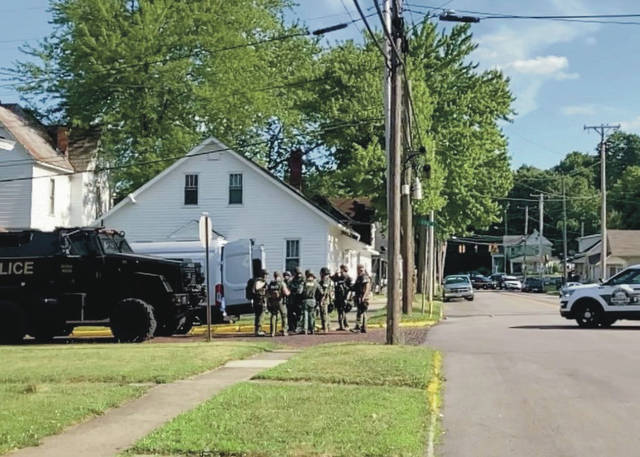 Tactical squad members respond to standoff at 300-block of South Walnut Avenue.