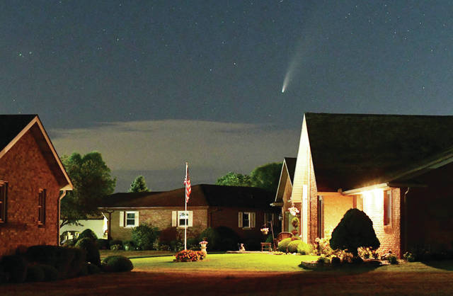 The comet NEOWISE hangs over Botkins on Friday, July 17. Its closest approach to Earth will occur on Thursday, July 23. The comet can be seen in the northwest sky right after sunset under the Big Dipper.