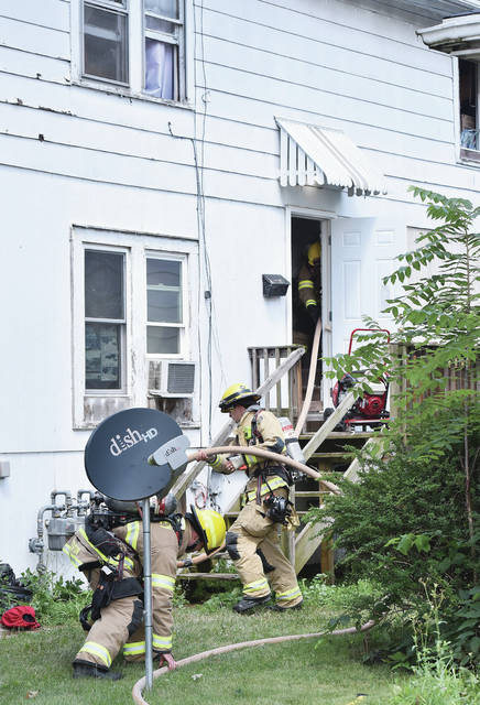 Sidney firefighters quickly extinguish a house fire at 434 N. Miami Ave. on Tuesday, July 21.