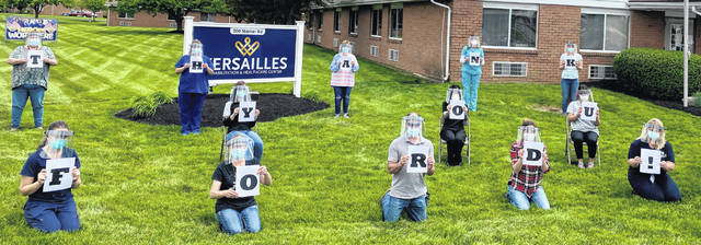 Versailles Rehab received hundreds of plastic face shields from Ford Motor Co. for the health care staff to wear when treating residents and patients at the care center.