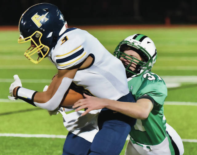 Anna's Justin Richards brings down Archbold's Antonio Cruz during the Division VI, Region 23 final on Nov. 22, 2019 at Lima Spartan Stadium. The OHSAA announced a proposal on Friday to shrink football's regular season to six games and open the playoffs to every team, which would result in the postseason lasting seven weeks.