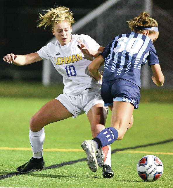 Lehman Catholic's Ella Monnin, left, tries to stop Cincinnati Country Day's Sydney Bortz during a Division III regional semifinal on Oct. 29, 2019 at Alumni Field in Centerville. The Ohio High School Athletic Association reiterated Monday contact sports scrimmages and competitions remain forbidden.