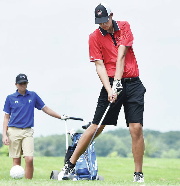 Fort Loramie's Austin Pleiman tees off during the SCAL boys golf preview on Monday at Shelby Oaks Golf Club. Fort Loramie finished first with a 321 team score, seven strokes ahead of second-place Botkins.
