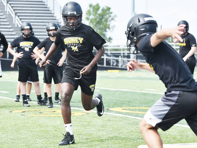 Sidney's Avante Martin runs during a practice on Aug. 1, 2019 at Sidney Memorial Stadium. Practices for all fall sports began across Ohio last week as the state continues to combat COVID-19 outbreaks. Sidney athletic director Mitch Hoying said practices at the school have been uneventful health-wise this summer and athletes are happy to have a bit of normalcy after the OHSAA shut down all activities from mid-March to late May.