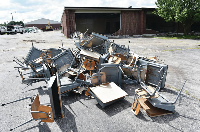 A pile of desks outside the New Bremen Elementary/Middle School.
