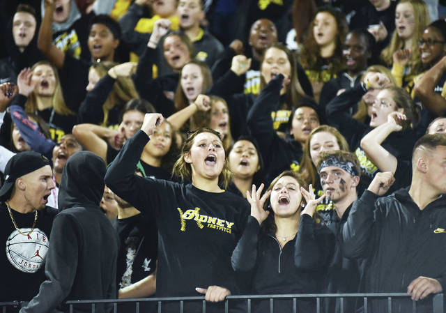 Sidney students cheer during a Greater Western Ohio Conference American North Division game against Piqua on Sept. 28, 2018 at Sidney Memorial Stadium. Seating capacity at the stadium will be limited to 1,125 this year due to COVID-19 safety precautions in an Ohio Department of Health order, and spectators must stay six feet apart.