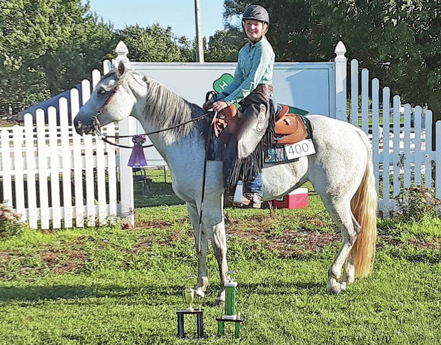 Elizabeth Low won Grand Champ Ranch Riding - Reserve Grand Champ English Showmanship and Reserve Grand Champ Trail at the 2020 Shelby County Fair.