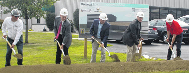 Brookside Laboratories had a ceremonial groundbreaking for a 36,000 square foot addition to its facility in New Bremen. Pictured, left to right, are Matt Bertke, project manager and estimator at H.A. Dorsten; Jerry S. Lehman Jr., president of First National Bank; Peter Maybach, chairmen of the Brookside board of directors; Luke Baker, president and CEO of Brookside Labs; and Robert Parker, mayor of New Bremen.