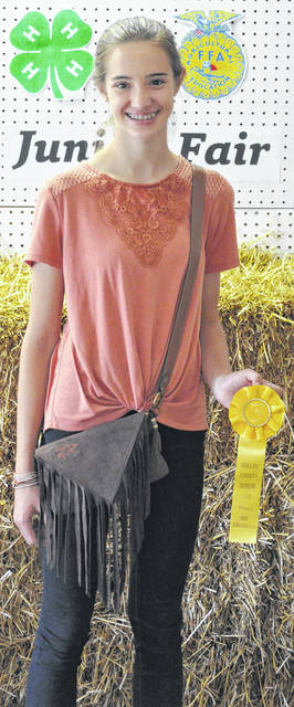 """Hannah Schneible, a member of Russia Fashionettes 4-H Club, won Best Construction for her """"Clothing for Middle School"""" project during the Monday, July 20, Junior Fair prefair judging show."""